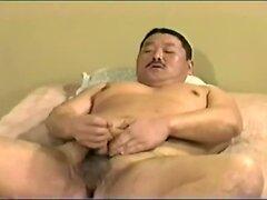 Chubby Japanese guy strokes
