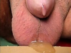 close up prostate milking with cumshoot at the end
